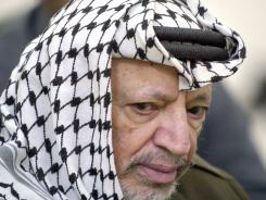 Palestinian leader Yasser Arafat listens to the Friday prayer sermon at his compound in the West Bank city of Ramallah on June 21, 2002.