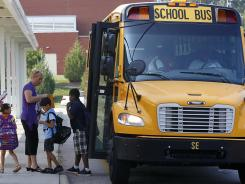Students return for their first day of classes at Barwell Road Elementary School in Raleigh, N.C., on Monday.