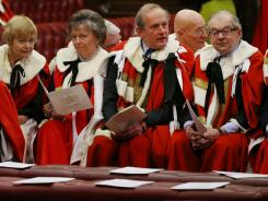 Members of the British House of Lords sit in the chamber May 9 in London.