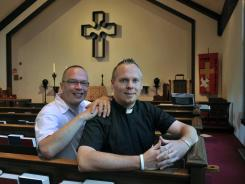 Rev. Christopher D. Hofer, right, and his partner of 17 years, Kerry Brady, sit in the Episcopal Church of St. Jude in Wantagh, N.Y. On Tuesday, Episcopalians approved a ceremony to bless same-sex couples.