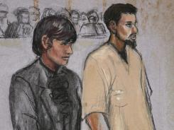 In this courtroom sketch, Rezwan Ferdaus, right, and his attorney Catherine Byrne stand during his arraignment hearing Oct. 3, 2011, in Worcester, Mass.
