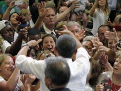 President Obama greets the crowd after speaking Tuesday at a campaign event in Cedar Rapids, Iowa.