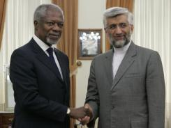 U.N. special envoy Kofi Annan, left, shakes hands with Saeed Jalili, Iran's chief nuclear negotiator, on Tuesday before meeting about Syria in Tehran.