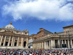 People gather on St. Peter's Square at the Vatican on June 24.