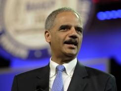 Attorney General Eric Holder speaks at the NAACP convention in Houston on Tuesday.