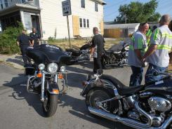 Motorcycles are removed from the clubhouse area of the Outlaws Motorcycle Gang in Indianapolis.