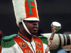 Robert Champion, a drum major in Florida A&M University's Marching 100 band, performs during a football game in Orlando in November. He died in a hazing incident aboard the band bus after the performance.