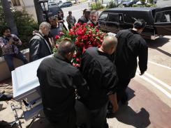 Relatives and friends of Anastasio Hernandez carry a casket out of a church after funeral services in 2010 in San Diego.