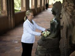 Secretary of State Hillary Rodham Clinton visits the Ho Phra Keo Temple in Vientiane, Laos, on Wednesday.