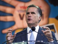 Mitt Romney speaks at the NAACP's annual convention Wednesday in Houston.