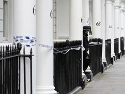 A police officer stands guard Wednesday outside the London home of Eva Rausing, who was found dead.