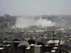 In this citizen journalism image provided Wednesday by Shaam News Network SNN, smoke leaps the air from purported shelling in Homs, Syria.