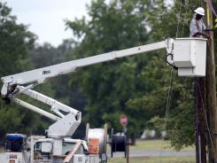 Downed power lines: Cleanup continues Monday in Spotsylvania County, Va., following damage caused by strong storms in the region. More than 2 million homes had no power for days.