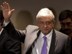 Andres Manuel Lopez Obrador, presidential candidate for the Democratic Revolution Party (PRD), waves during a news conference in Mexico City on Thursday.