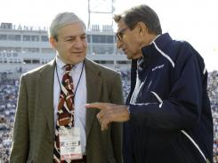 Penn State President Graham Spanier, left, and head football coach Joe Paterno chat during warmups before an NCAA college football game against Iowa, in State College, Pa., last October.
