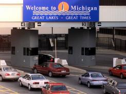 Motorists line up to enter Detroit from Windsor, Ontario, through U.S. Immigration and Naturalization Services and U.S. Customs on the Detroit side of the Detroit-Windsor Tunnel in this 1999 photo.