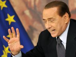 Former Italian prime minister Silvio Berlusconi gestures during a press conference on June 30, 2011, at Palazzo Chigi in Rome.