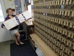 Becky Sweeney picks up a package at the post office in Websterville, Vt., on May 9.