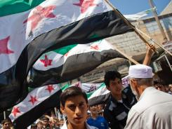 Thousands of Syrians from Mareh, a city in the northern countryside of Syria, protest Friday against the massacre in Treimsa, in Hama province,.