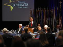 Virginia Gov. Bob McDonnell, at podium, addresses the National Governors Association meeting in Williamsburg, Va.