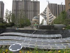 Energy-saving design: Solar panels evoking a dragon in flight greet visitors to Utopia Garden, an eco-friendly apartment complex in Dezhou, China, that uses coal-fired electricity for more than 90% of its power needs.