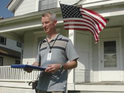 Census taker Timothy Culp-Northwood does follow-up visits to homes in Racine, Wis., in 2010.