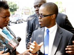 The Rev. Jean Louis, son of kidnapped Rev. Michel Louis, speaks to the media Sunday in Boston.