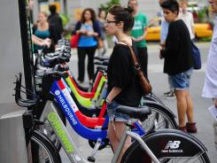A New York resident looks at a demo of a new bicycle sharing system last September.