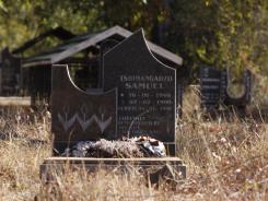 A headstone marks the grave in Nweli, South Africa, where Benedict Daswa is buried.