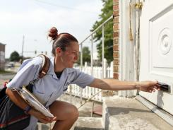 Monique Miller delivers mail in Philadelphia this month.