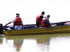 Volunteers check Meyers Lake in Gilbertville, Iowa, during Sunday's search for Elizabeth Collins and her cousin Lyric Cook-Morrissey.