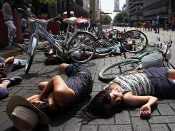 Activists lie on the street pretending to be dead during a flash mob in Guadalajara, Mexico, on May 6.