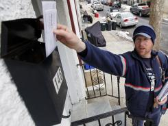Kevin Pownall delivers mail in Philadelphia in 2010.