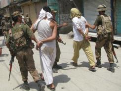 Pakistan army soldiers escort alleged suspects arrested during a crackdown against militants in Bannu, Pakistan, on Monday.
