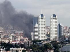Smoke billows over Istanbul's Besiktas district after a fire on Tuesday.