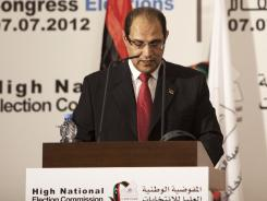 Nouri al-Abbar, a member of the High National Elections Commission, speaks during the announcement of the election results in Tripoli.