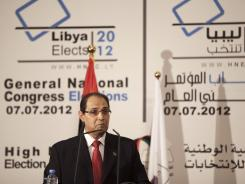 A member of the High National Elections Commission, Nouri al-Abbar, talks during the announcement of the election results in Tripoli, Libya, on Tuesday.