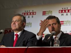 Enrique Pena Nieto, right, and Colombian retired general Oscar Naranjo attend a press conference in Mexico City on June 14.