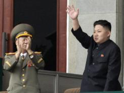 North Korean leader Kim Jong Un waves during a meeting of the country's ruling party on April 14 in Pyongyang.
