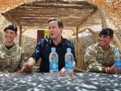 British Prime Minister David Cameron meets with British soldiers based at Lashkar Gah in Helmand Province on Wednesday.