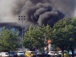 Smoke billows Wednesday over Bourgas airport after the bombing of an Israeli tour bus.