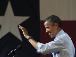 President Obama waves to the crowd as he arrives to speak at a fundraising event in Austin, Texas, on Tuesday.
