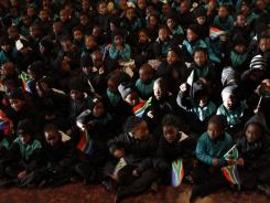 "Children sing ""Happy Birthday"" for former South African president Nelson Mandela on Wednesday in Johannesburg."