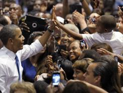 President Obama greets the crowd after speaking at a campaign event at the Prime Osborn Convention Center in Jacksonville, Fla., on Thursday.