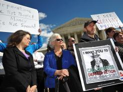 Protesters outside the Supreme Court call for a reversal of the 2010 Citizens United decision.