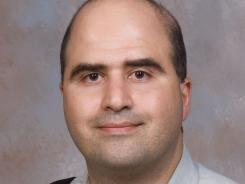 Maj. Nidal Hasan is shown in this 2007 photo provided by the Uniformed Services University of the Health Sciences.