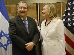 Secretary of State Hillary Clinton talks with Israeli Defense Minister Ehud Barak in Jerusalem on Monday.