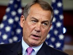 House John Boehner, R-Ohio, talks to reporters on Thursday.