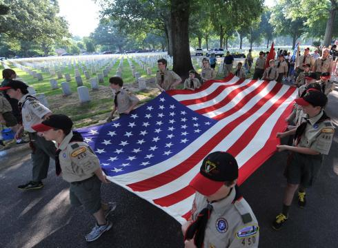Leading the parade: Boy Scouts members march in a Memorial Day ceremony in ...