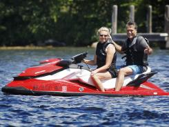 Jet set: Mitt Romney and his wife, Ann, on New Hampshire's Lake Winnipesaukee on July 2.